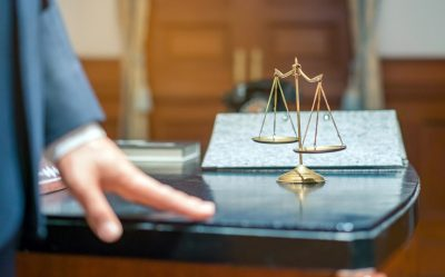 Soft focus of Judge think about the case that must be considered in the court. Selective focus on court scale.
